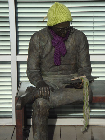 Bronze Young Man Reading